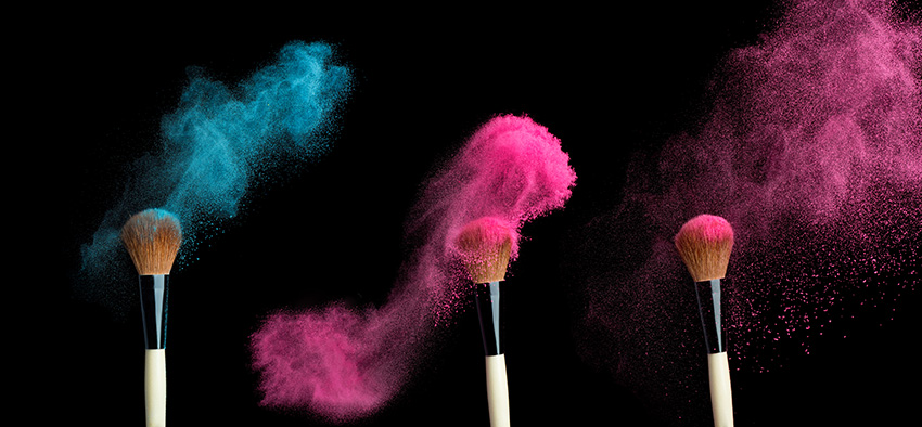 powderbrush on black background with blue powder splash  close up