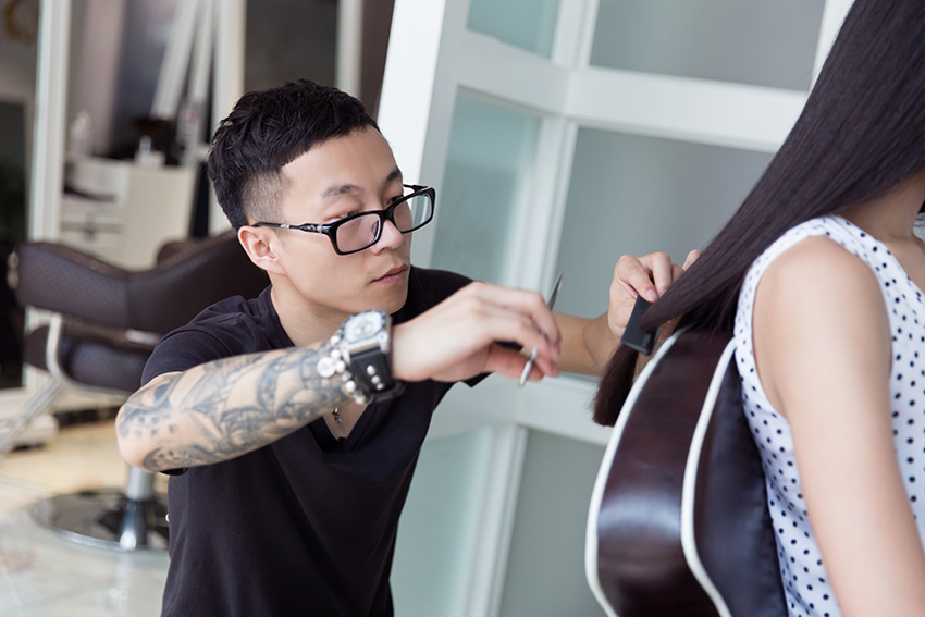 china professional hair stylist, at a pretty girl trim long hair